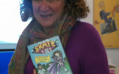 "Dr. Barbara ""Bobbi"" Kurshan showing off her copy of the Skate 101 DVD"